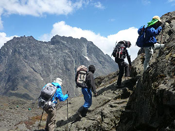 A group of people hiking the Rwenzori Mountains