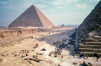 Tourists enjoying the sight of the Great Pyramids of Giza, Egypt