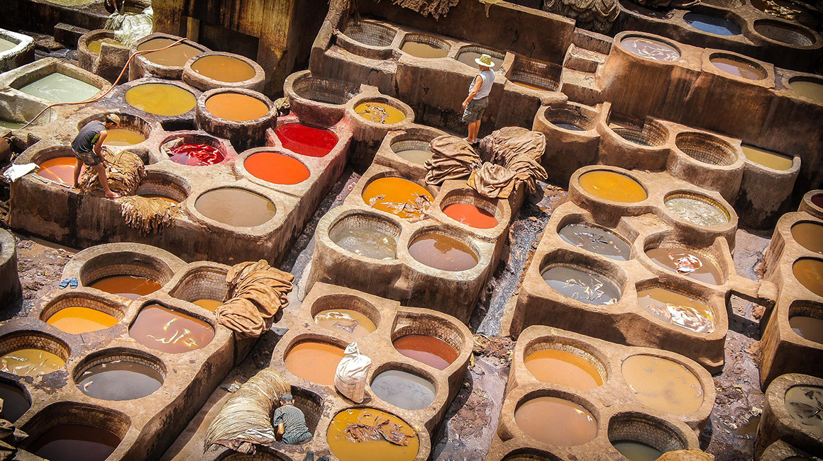 The maze-like medina colorful leather-dying pits in Fez, Morocco are a must visit for tourists visiting north Africa.