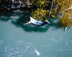 A tourist durinig a bungee jumping session in Africa